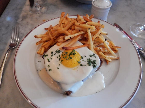 Croque Madame with a side of Truffle Fries at Bouchon Bistro
